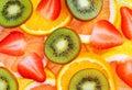 Sliced fruits background strawberry kiwi pineapple grapefruit and orange Stock Photos