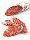 Sliced fuetsausage fuet sausage on white base Royalty Free Stock Photos
