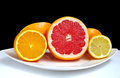 Sliced grapefruit, orange and lemon Stock Images