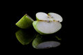 Sliced green apple from side with reflection Royalty Free Stock Photo