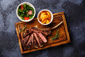 Sliced grilled Veal rib with potato wedges and salad Royalty Free Stock Photo