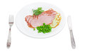Sliced ham and smoked cheese, green peas, fork and knife Royalty Free Stock Photo