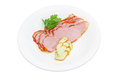 Sliced ham and smoked cheese on a white plate Royalty Free Stock Photo