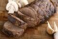 Sliced juicy beef tenderloin on wooden plate Stock Image