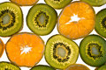Sliced kiwis and mandarins Stock Photography