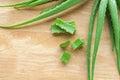 sliced and leaf of fresh aloe vera on wood