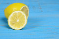 Sliced lemon on blue wood Royalty Free Stock Photo