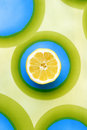 Sliced lemon on colourful patterned cloth Royalty Free Stock Image