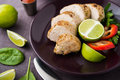 Sliced lime pork tenderloin on dark canvas background close up Royalty Free Stock Photo