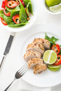 Sliced lime pork tenderloin with spinach salad on white background Royalty Free Stock Photo