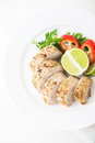 Sliced lime pork tenderloin on white wooden background top view Royalty Free Stock Photo