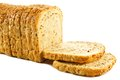 Sliced loaf of bread with grains over a white background Royalty Free Stock Photos