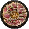 sliced meat with onion on the plate over white Royalty Free Stock Photo