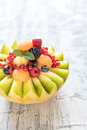 Sliced melon with berry fruit Royalty Free Stock Photo