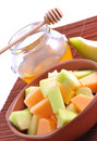 Sliced melon with honey Stock Image