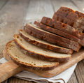 Sliced monastery rye bread on cooking board Royalty Free Stock Images