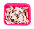 Sliced mushrooms in box isolated on white Stock Photo