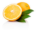 Sliced orange fruit with leaves isolated on white background Stock Photo
