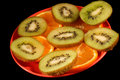 Sliced Orange and kiwi on plate Royalty Free Stock Photography