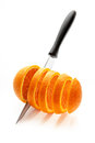 Sliced orange ripe sharp knife on a white background Stock Photography