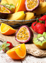 Sliced passion fruit and tropical fruits Royalty Free Stock Photo