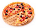 Sliced Pizza with olives on wooden plate isolated Royalty Free Stock Image