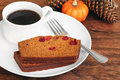Sliced Pumpkin Cranberry Cake with Coffee Royalty Free Stock Photography