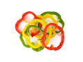 Sliced red yellow green bell pepper on white background Royalty Free Stock Photo