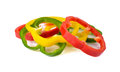 Sliced red yellow green bell pepper on white background Stock Photo