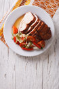 Sliced roasted turkey breast and fresh vegetables. vertical top Royalty Free Stock Photo