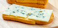 Sliced roquefort cheese over toast bread Stock Photo