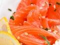 Sliced salmon with sesame seeds and lemon Stock Photos