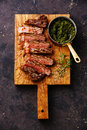 Sliced Sirloin steak with chimichurri sauce Royalty Free Stock Photo