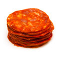 Sliced spanish chorizo sausage closeup of stack of isolated on white background Stock Photo