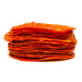 Sliced spanish chorizo sausage side view of in pile or stack isolated on white background Royalty Free Stock Photos