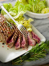 Sliced steak with  salad Stock Photos