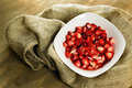 Sliced strawberries bowl wooden background Royalty Free Stock Photography