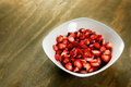Sliced strawberries bowl wooden background Royalty Free Stock Images