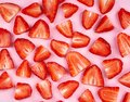 Sliced strawberry on pink background Royalty Free Stock Photo
