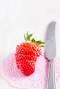 Sliced strawberry and knife Royalty Free Stock Photo