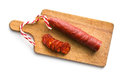 Sliced tasty chorizo sausage on cutting board Stock Image