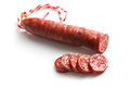 Sliced tasty chorizo sausage on white background Royalty Free Stock Photography
