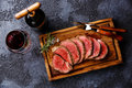 Sliced tenderloin Steak roastbeef and Red wine Royalty Free Stock Photo