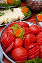 Sliced tomatoes on buffet with assortment of different food in background Stock Photo