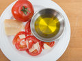 Sliced tomatoes and parmesan cheese plate of vine ripened red tomato with olive oil Stock Images