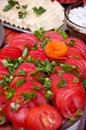 Sliced tomatoes platter of fresh juicy on a buffet table Stock Photography