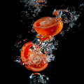 Sliced tomatoes in the water Royalty Free Stock Images