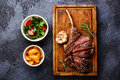 Sliced Veal rib with potato and salad Royalty Free Stock Photo