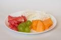 Sliced watermelon, cantaloupe, cheese, grapes Royalty Free Stock Photo