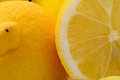 Sliced and whole lemons details of fresh juicy ripe Stock Photo